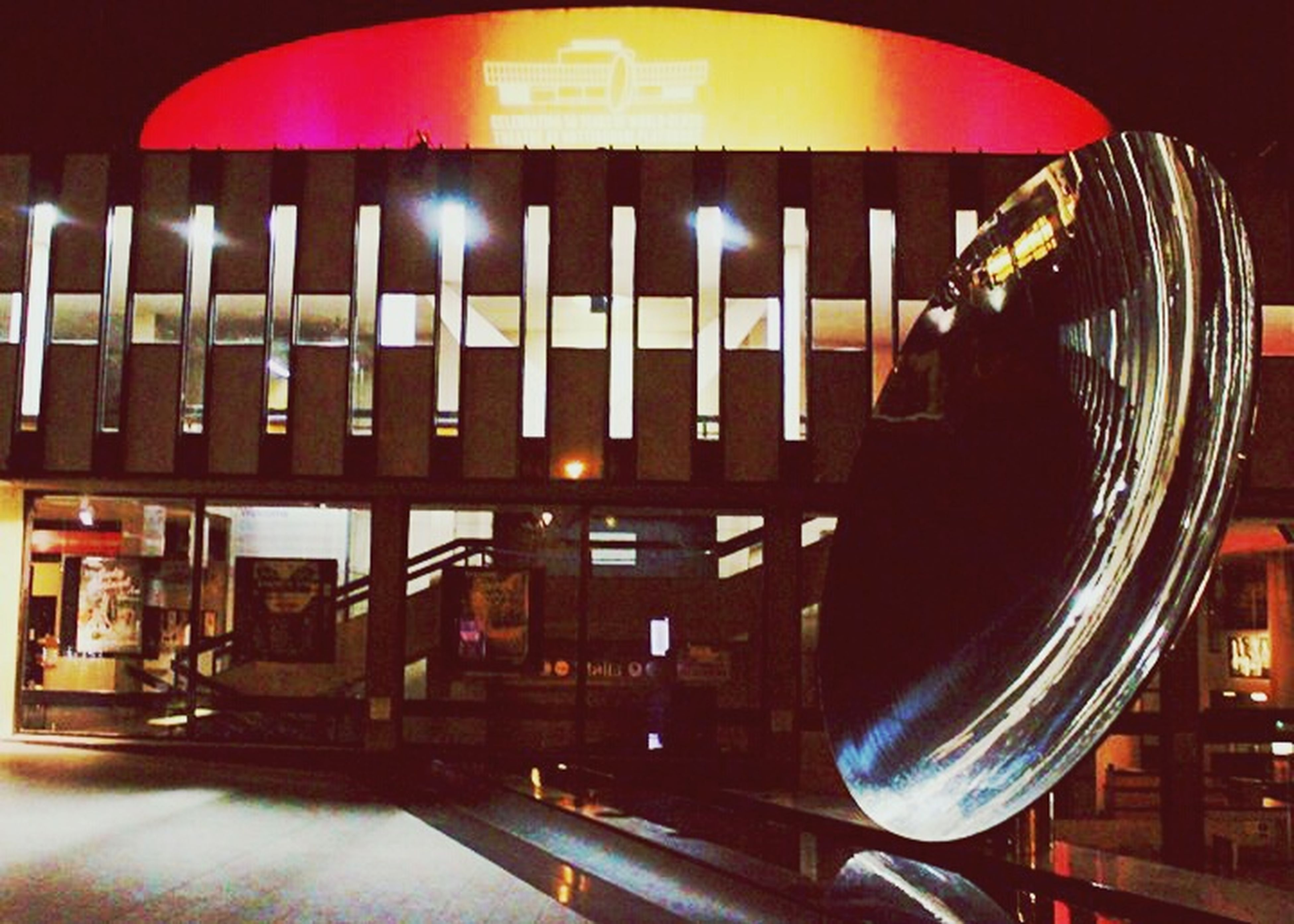 illuminated, night, architecture, built structure, building exterior, city, indoors, transportation, long exposure, incidental people, architectural column, arts culture and entertainment, modern, red, railing, blurred motion, lighting equipment, travel, speed, no people