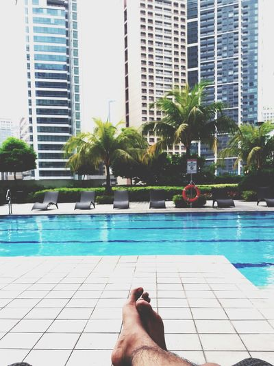 When you are so done with all the toxics and stress. Poolside Barefoot Summer Relaxation Outdoors City Cityscape