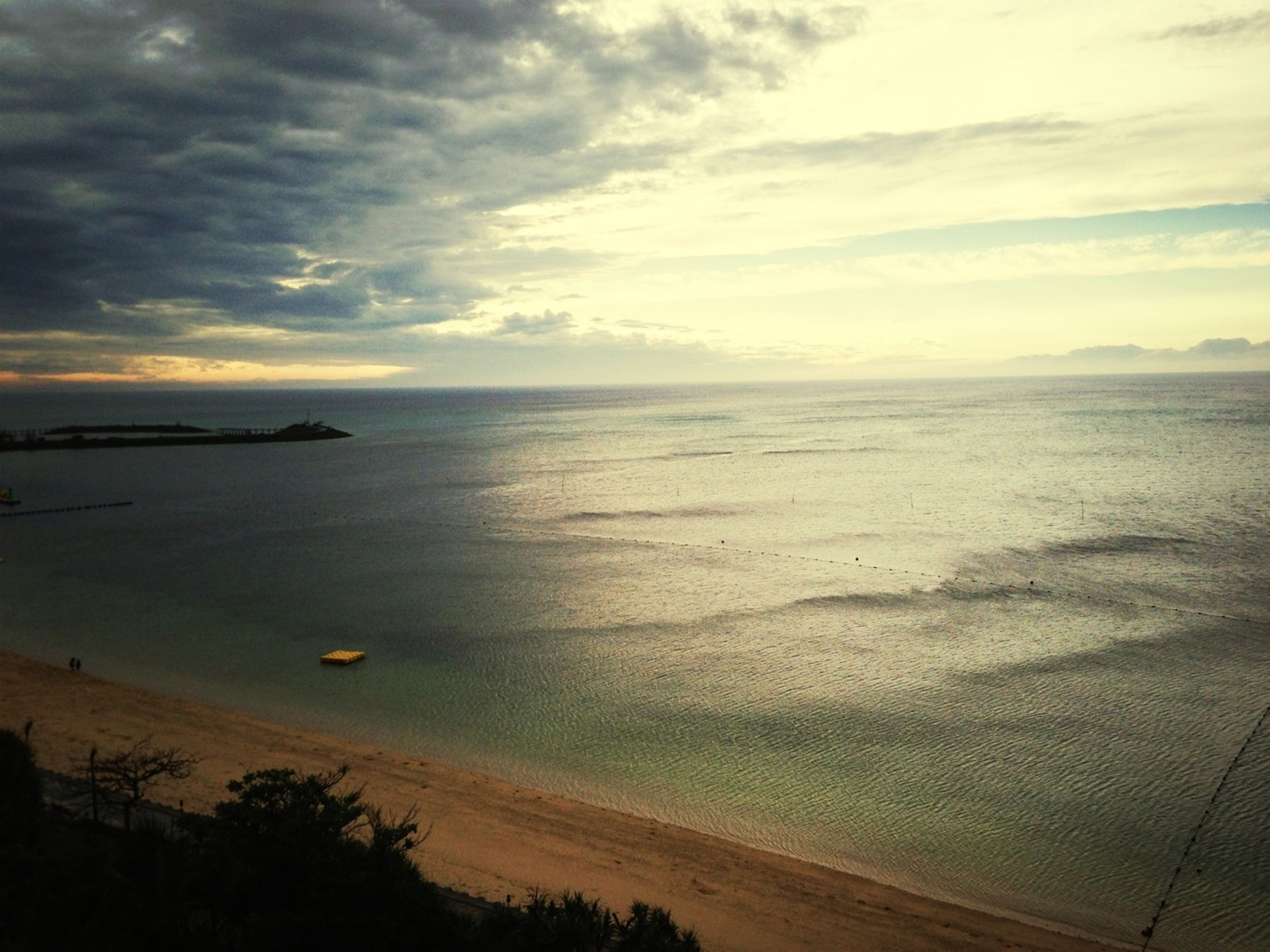 sea, horizon over water, beach, sky, water, tranquil scene, scenics, tranquility, shore, beauty in nature, sand, nature, cloud - sky, idyllic, sunset, cloud, coastline, cloudy, calm, remote