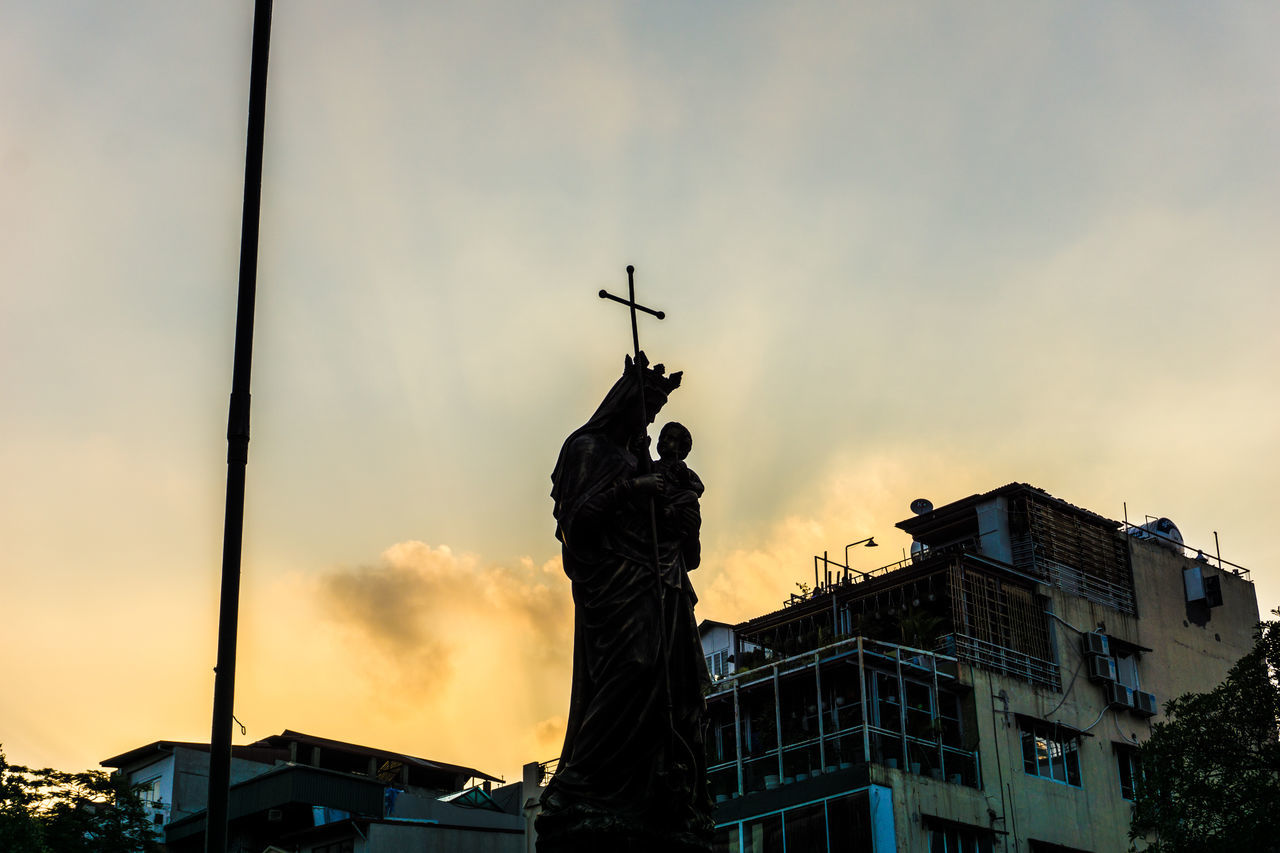 Low Angle View Of Virgin Mary Statue With Jesus Christ Against Sky