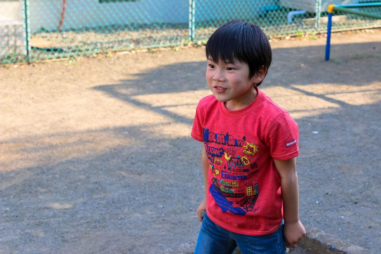 Boy Enjoying At Playground