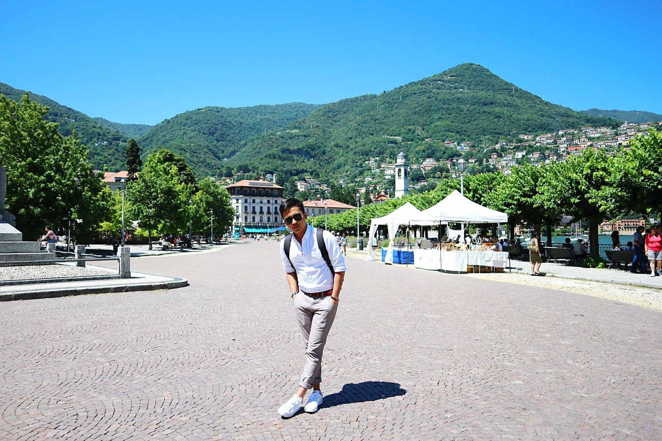 Clear Sky Full Length Leisure Activity Lifestyles Playing Tree Casual Clothing Mountain Person Day Young Adult Outdoors Blue Hobbies Nature Scenics Beauty In Nature Lakecomo Italy
