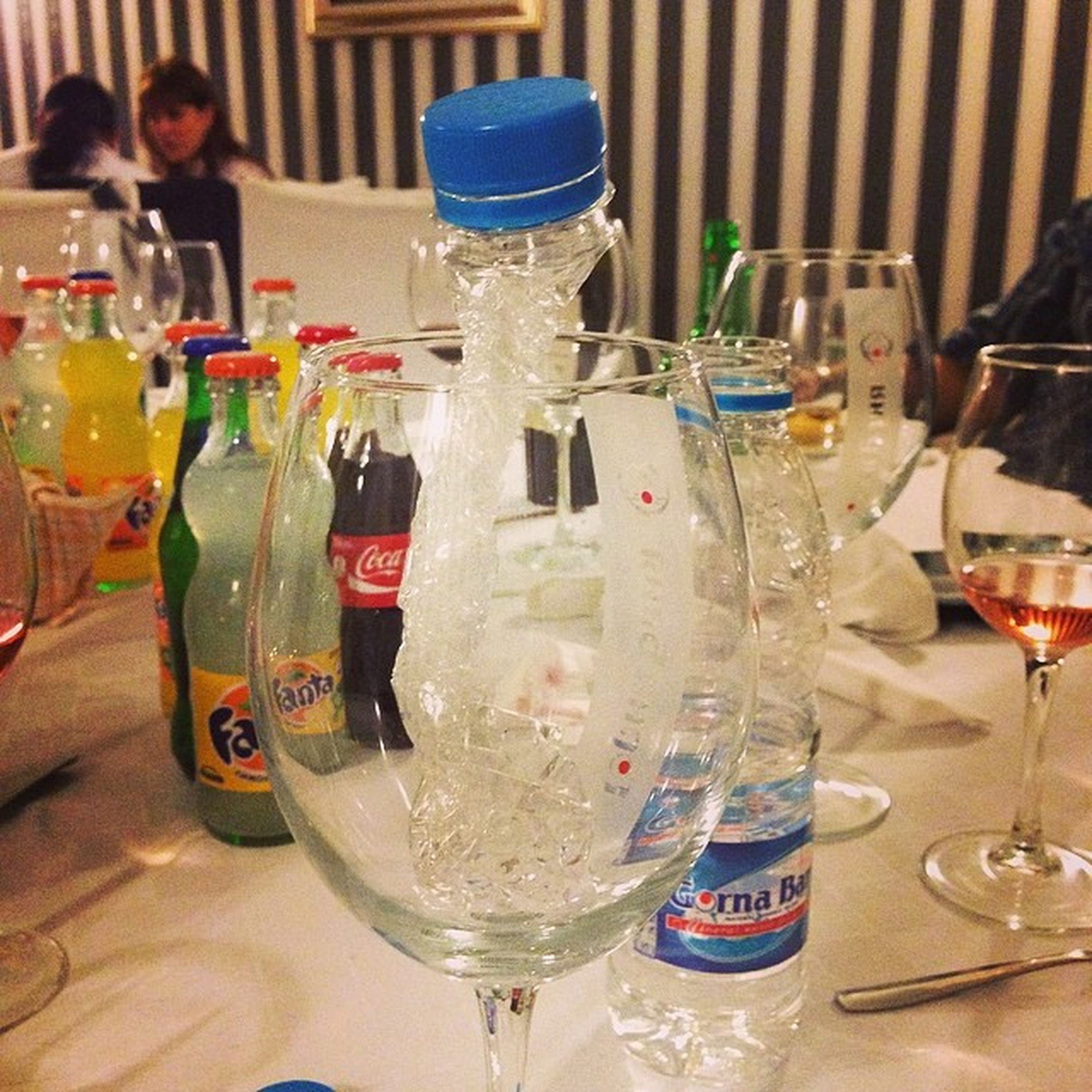 drinking glass, indoors, drink, food and drink, refreshment, wineglass, table, alcohol, glass - material, still life, transparent, bottle, wine, restaurant, close-up, freshness, glass, focus on foreground, alcoholic drink, arrangement
