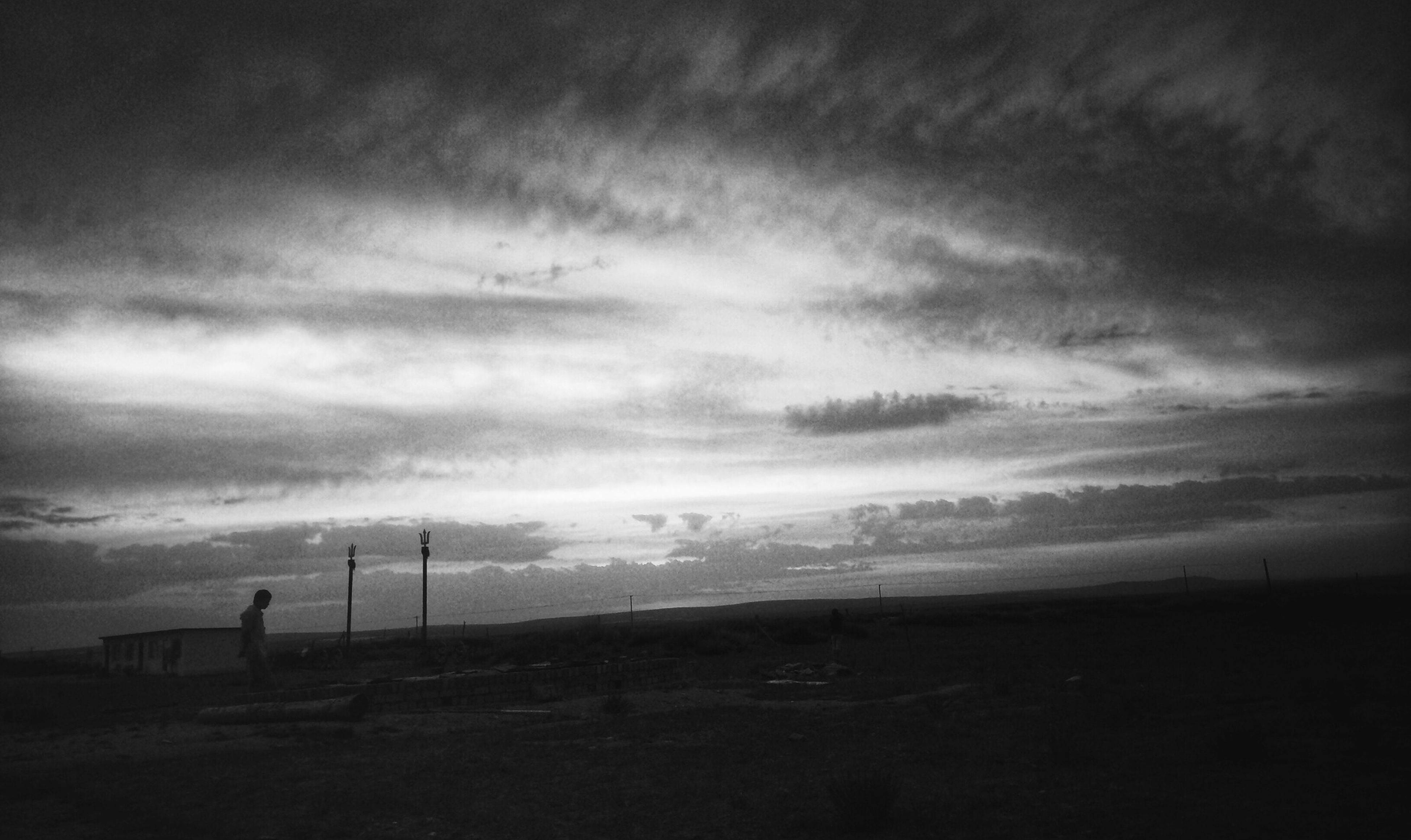 sky, cloud - sky, tranquility, landscape, tranquil scene, cloudy, scenics, field, nature, beauty in nature, weather, overcast, cloud, dusk, silhouette, beach, outdoors, horizon over land, no people, remote