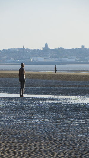 Statue Ankle Deep In Water Another Place By Anthony Gormley Beach Beauty In Nature Clear Sky Day Full Length Leisure Activity Lifestyles Men Nature Outdoors Scenics Sea Sky Standing Vacations Water