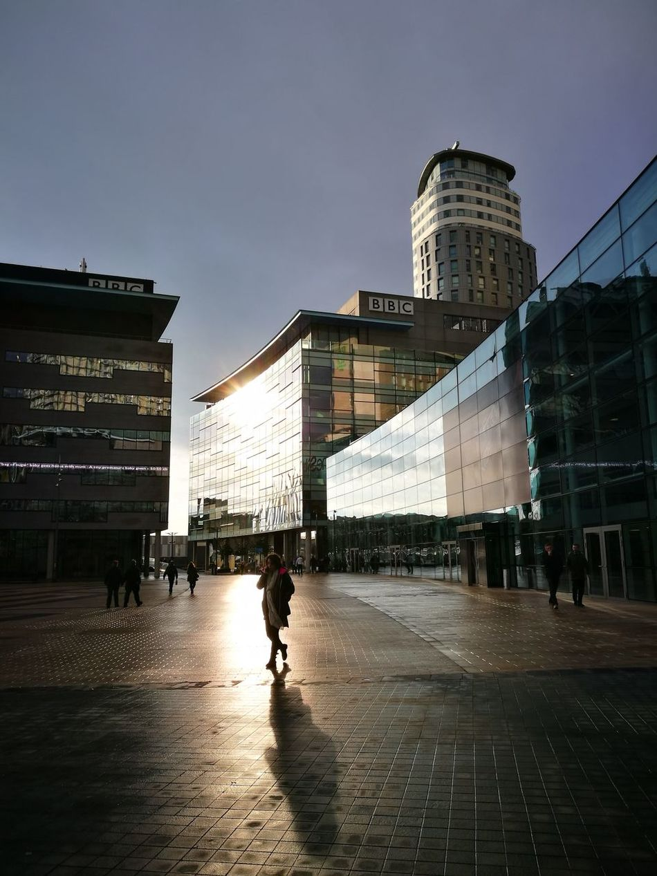 Built Structure Silhouette Architecture City Travel Destinations History Water Sky Outdoors Illuminated Adult Day Wintersun Mediacityuk SalfordQuays Manchester Silhouette City Only Men People Adults Only Adapted To The City