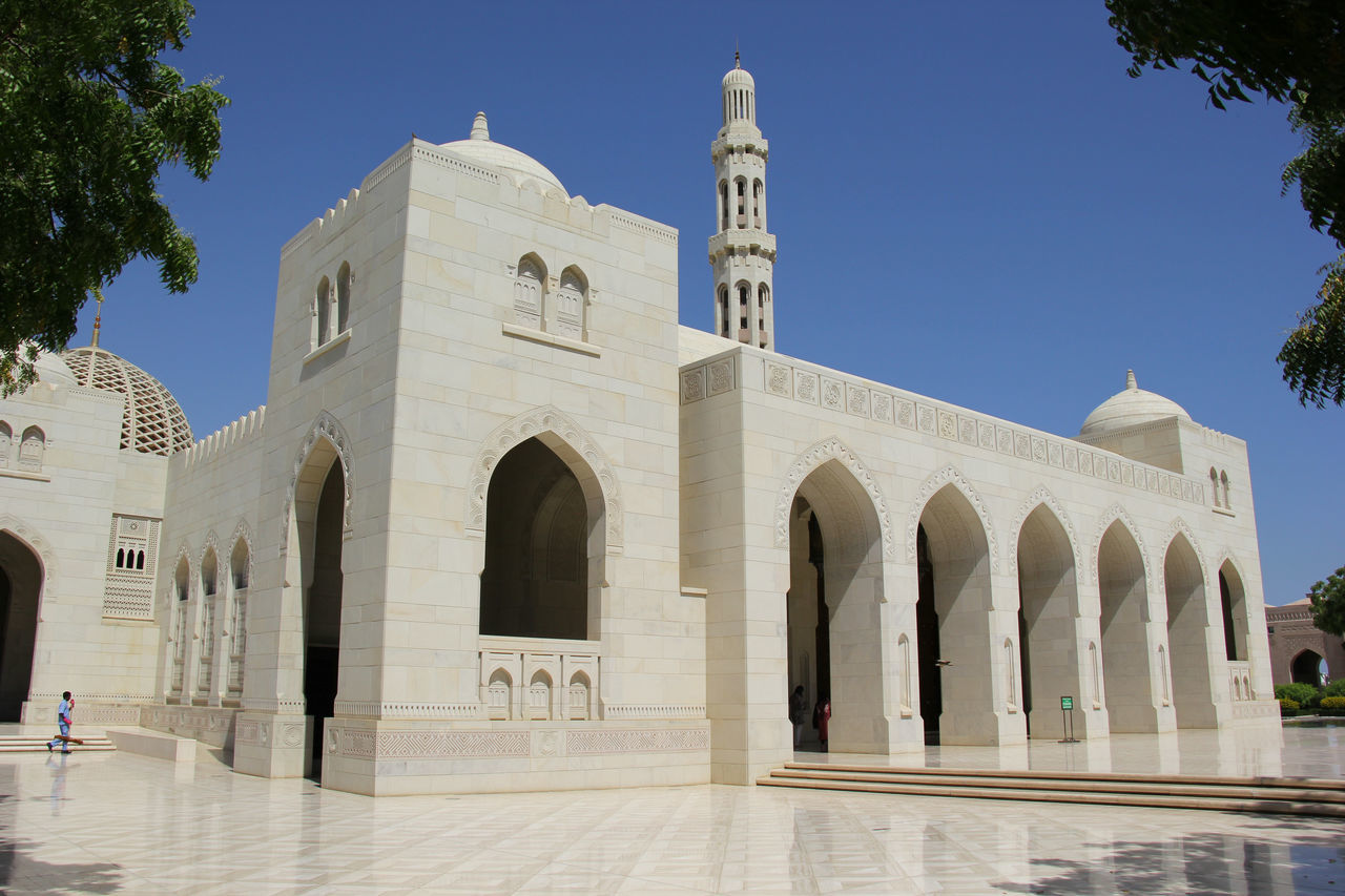 Arabic Arabic Architecture Arch Architectural Column Architecture Building Exterior Built Structure Clear Sky Day History Minaret Mosque Muscat Muscat , Oman Oman Outdoors Place Of Worship Real People Religion Sky Spirituality Sultan Qaboos Grand Mosque Travel Destinations Tree
