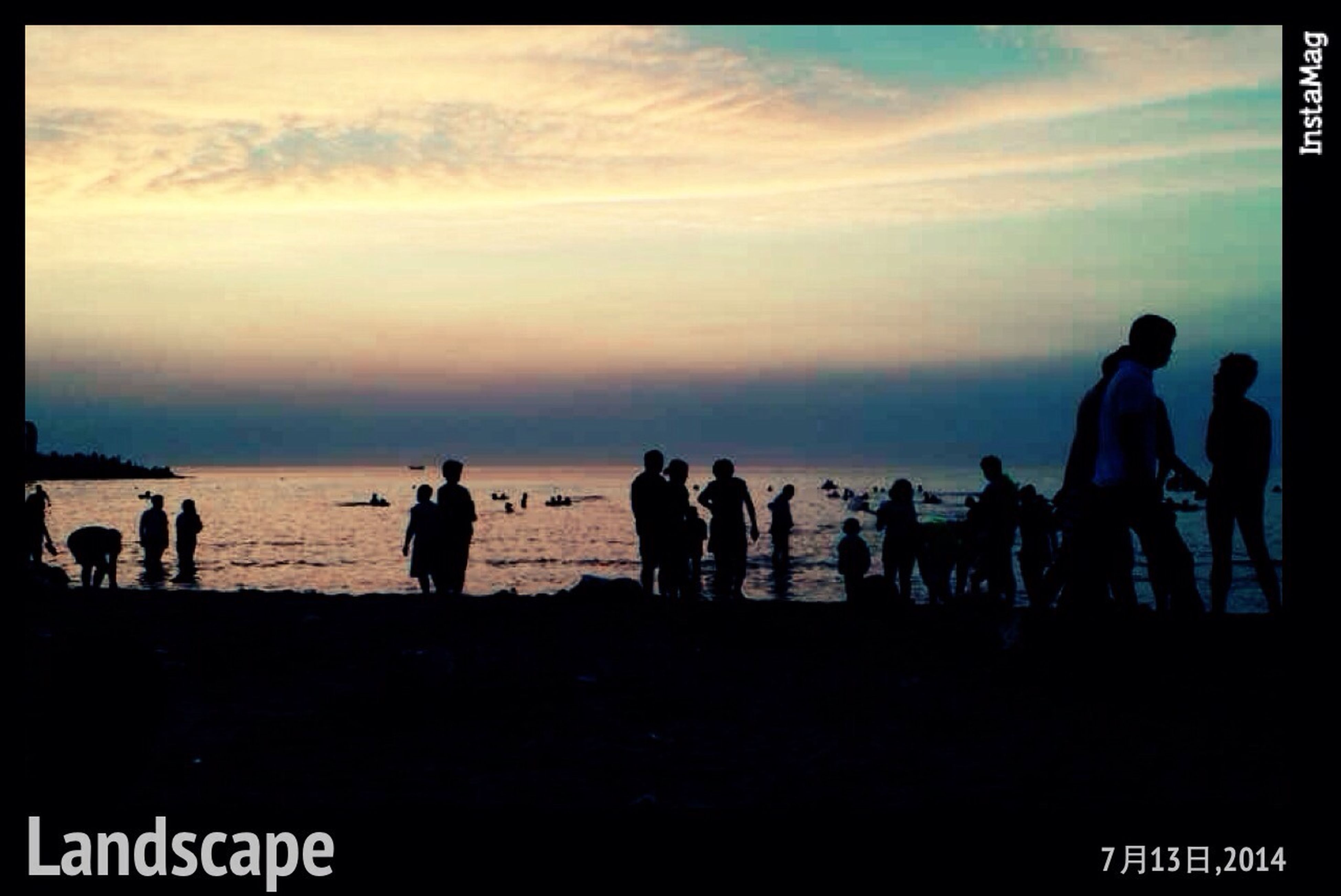 large group of people, men, lifestyles, sky, person, transfer print, silhouette, leisure activity, togetherness, sunset, cloud - sky, auto post production filter, mixed age range, standing, medium group of people, enjoyment, vacations, outdoors, water