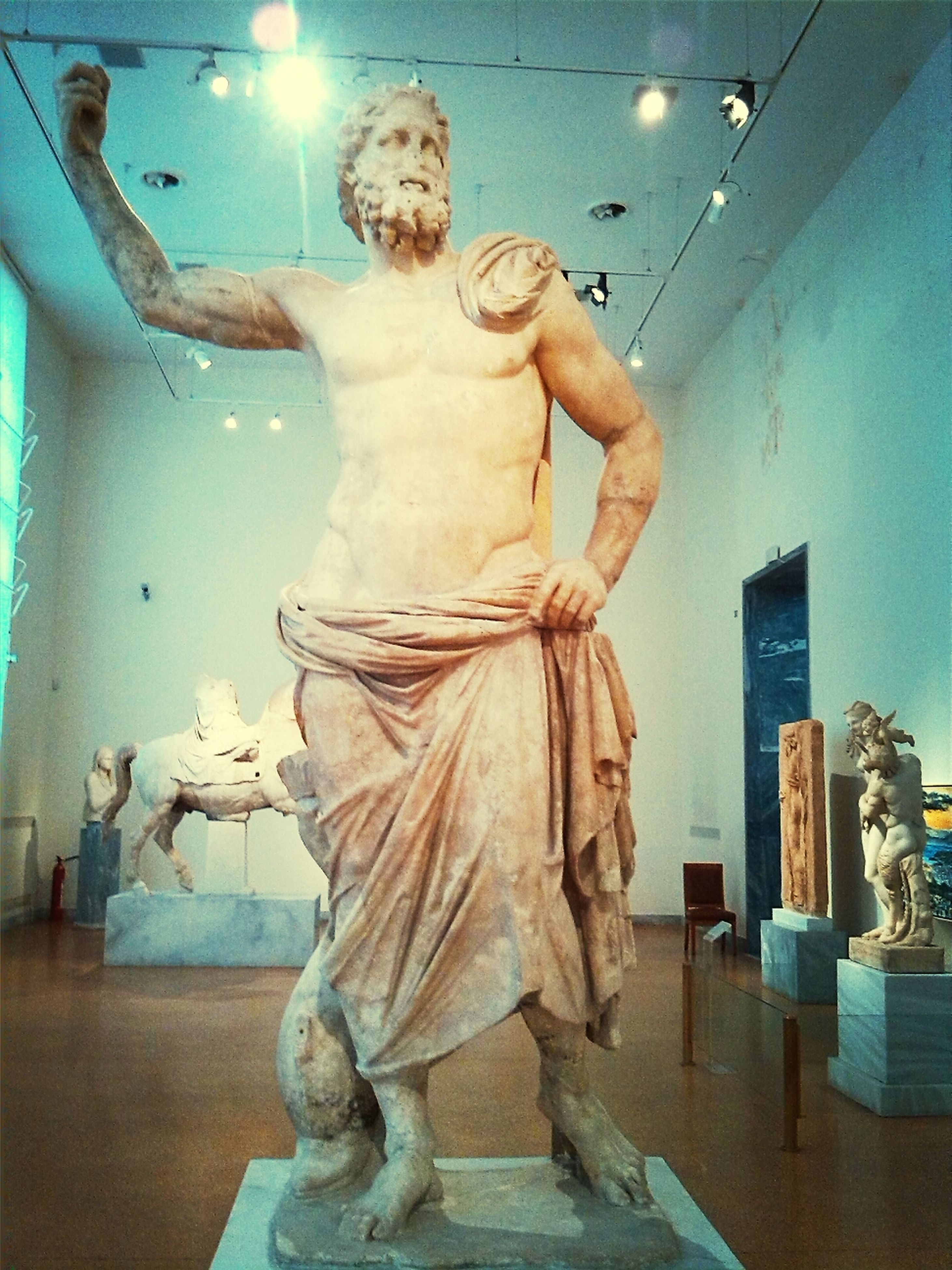 human representation, statue, sculpture, art, art and craft, creativity, indoors, animal representation, low angle view, full length, built structure, water, architecture, carving - craft product, day, figurine, craft