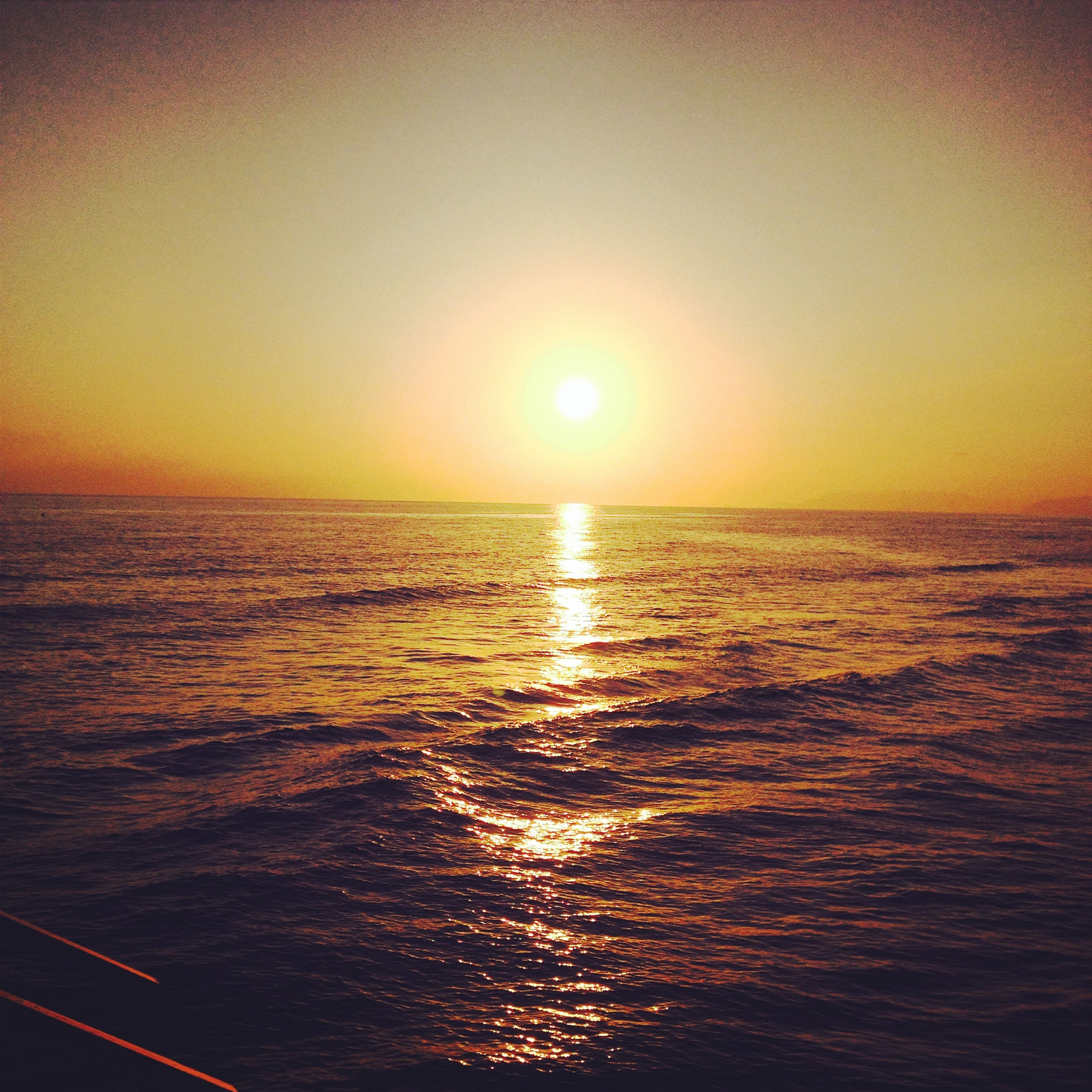 sunset, sea, sun, water, horizon over water, scenics, orange color, tranquil scene, beauty in nature, tranquility, reflection, idyllic, waterfront, nature, rippled, clear sky, sunlight, seascape, sky, nautical vessel