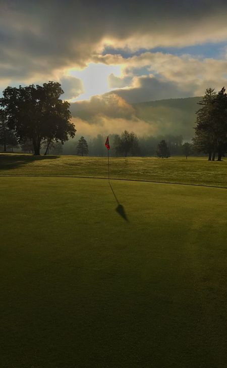 Morning sunrise Golf Golf Course Tree Sport Green - Golf Course Grass Cloud - Sky Leisure Activity Sky Beauty In Nature Nature Flag Green Color Golf Club Tranquility Golfer Taking A Shot - Sport Scenics Outdoors Day