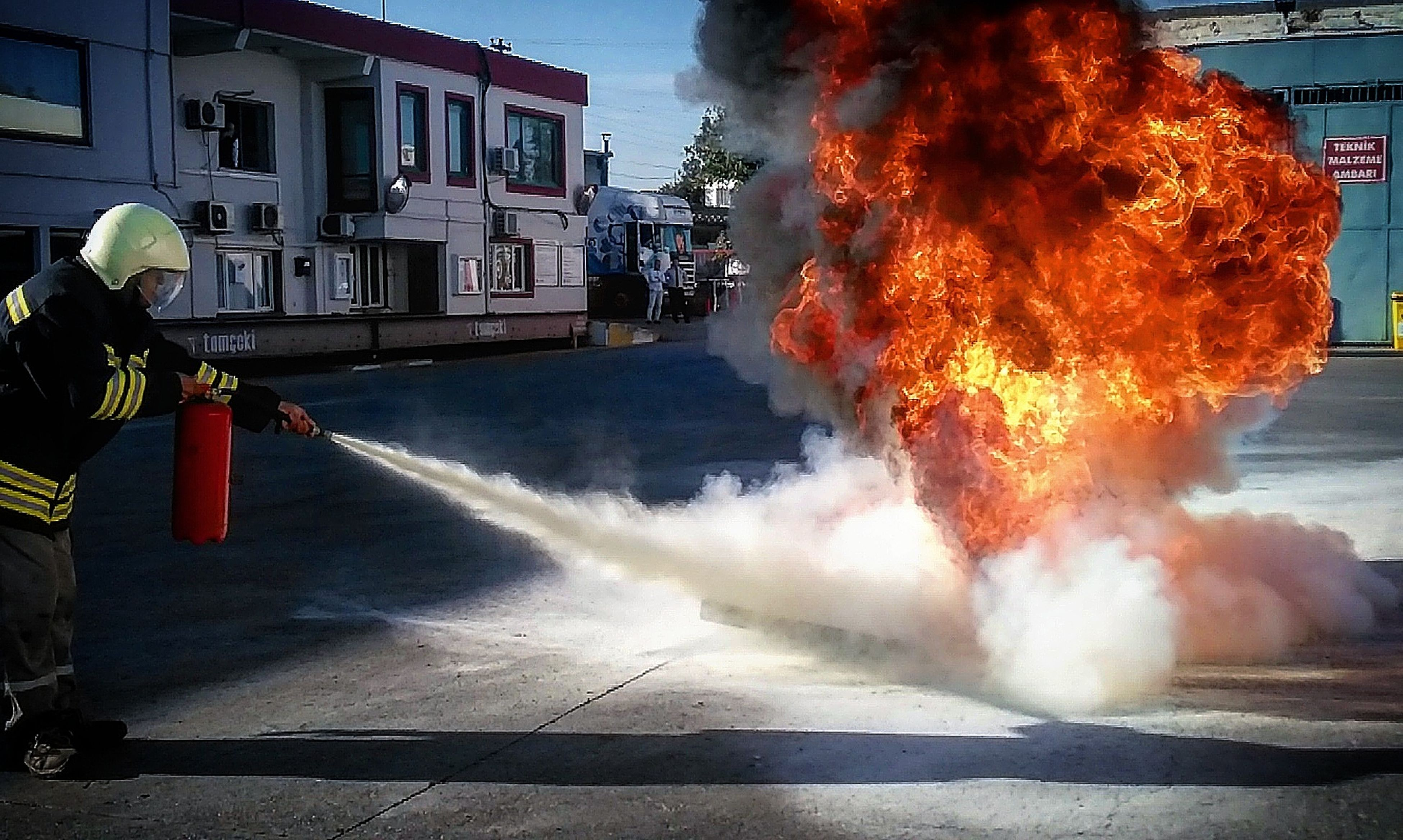 building exterior, outdoors, smoke - physical structure, courage, built structure, exploding, heat - temperature, firefighter, sky, rescue, night, water, adults only, emergency equipment, only men, people, adult