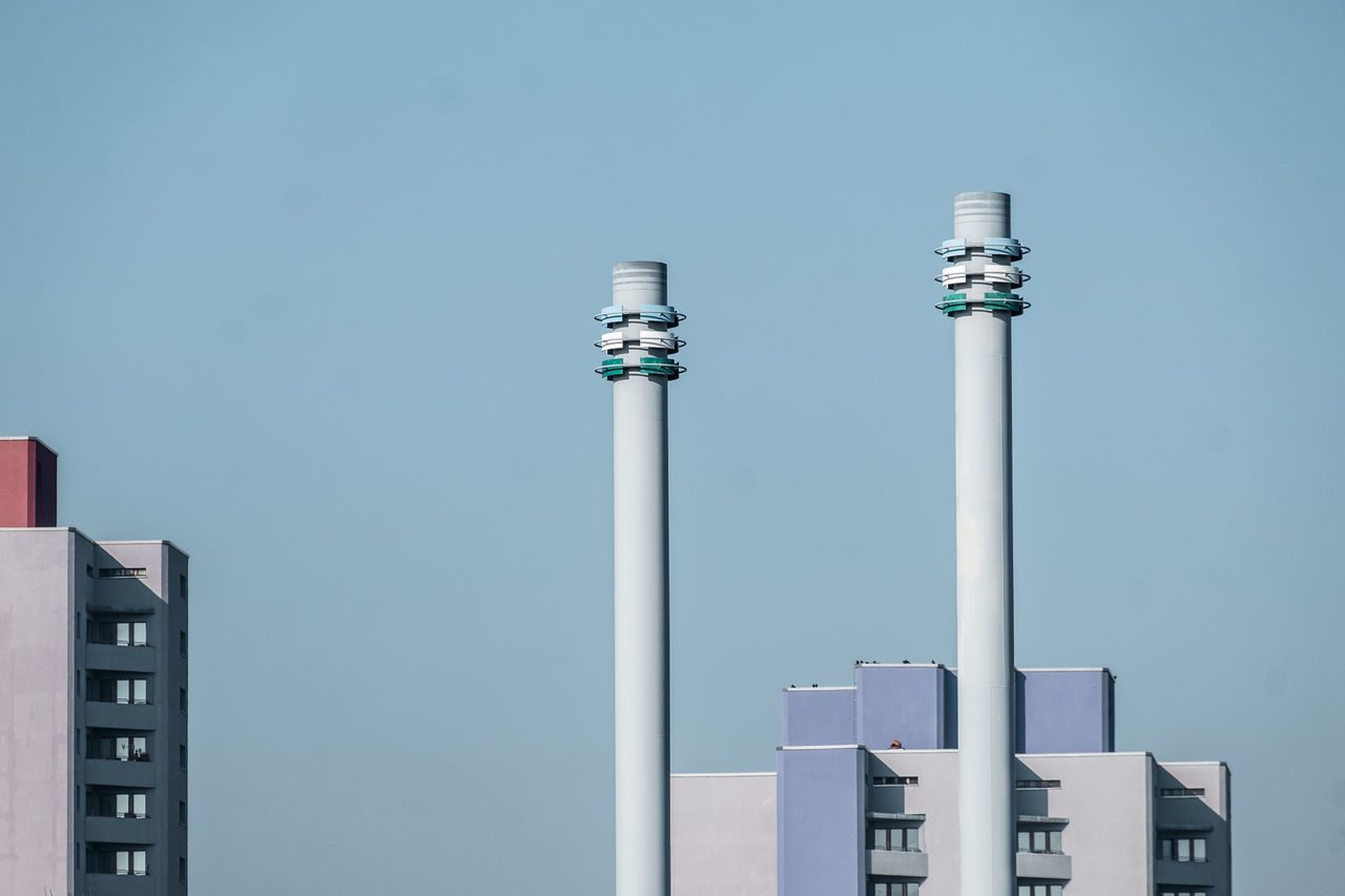 Smoke Stacks Against Clear Sky