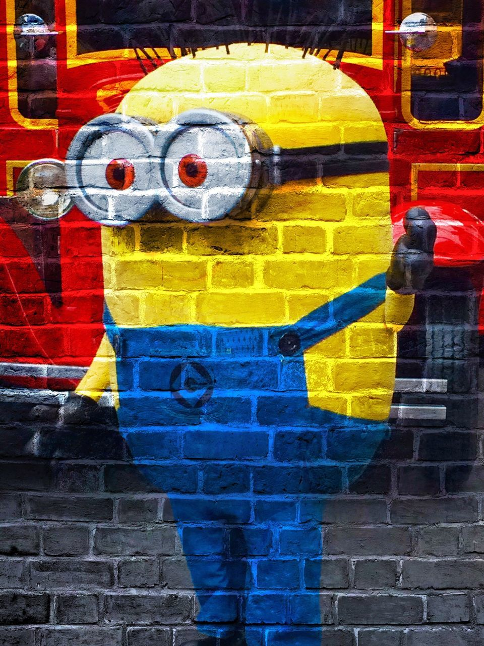 yellow, brick wall, graffiti, outdoors, day, paint, built structure, architecture, multi colored, red, human body part, building exterior, one person, aerosol can, close-up, people