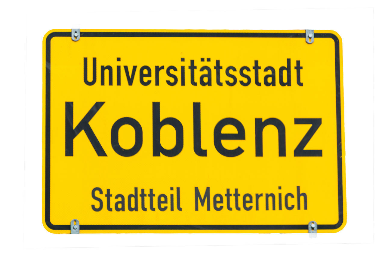 City limit sign Koblenz against white background - Koblenz signage - University City, Germany Black Color City Limits Koblenz No People Road Sign Text Town Entrance Sig White Background Yellow