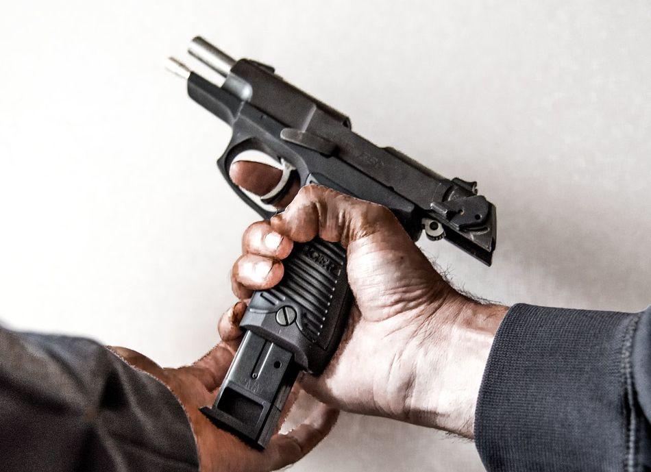 Loading a handgun point of view Adult Aiming Ammunition Close-up Criminal Danger Dirty Gun Guns Handgun Hands Horizontal Human Body Part Law Law Enforcement Men Nra People Pistol Police Self-defense Shooting Theif Weapon White Background