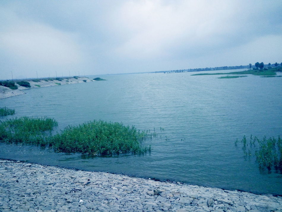 Pangal Reservoir Water Nature Sea Blue Sky Outdoors No People Day Backgrounds Tree Horizon Over Water Beauty In Nature Scenics Beach Natural Disaster LeEco1sEco UVsPhotography Reservoir Reflection Grass In Water