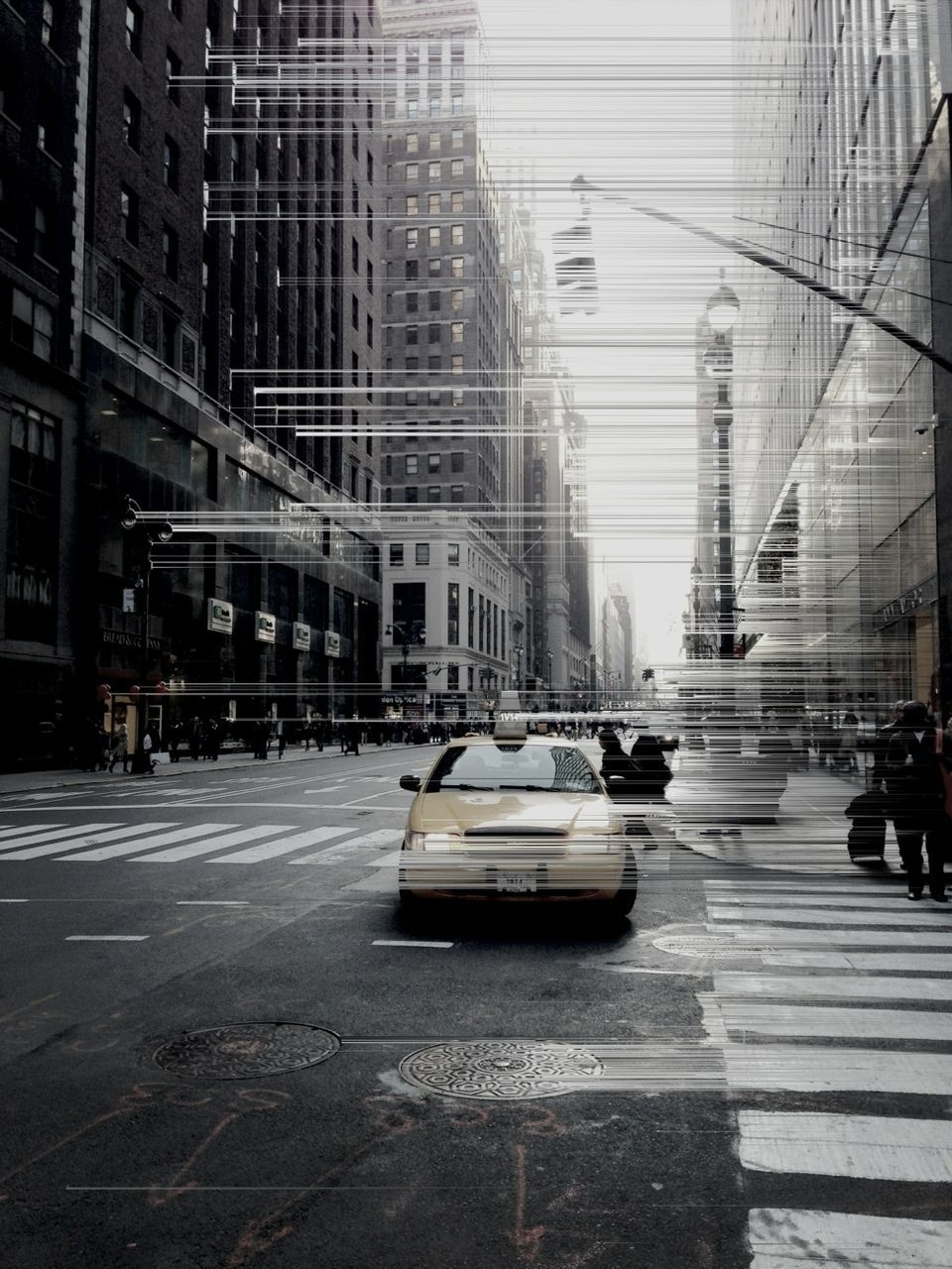 car, architecture, city, building exterior, transportation, built structure, land vehicle, street, mode of transport, road, yellow taxi, city life, skyscraper, outdoors, city street, day, travel destinations, no people, cityscape