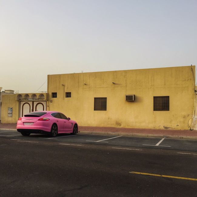 Urban Pink Fever / captured in Dubai with my iPhone6 Urban Spring Fever Car Cars Porsche Enjoying Life Mydubai Dubai EyeEm Best Edits Streetphotography Architecture EyeEm Best Shots Scenics Check This Out Check This Out Hello World Tranquility Taking Photos Hanging Out Cheese! Pink Beauty In Nature Standing Lonely Eye4photography