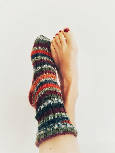 bare Skin Fashion Woolen Sock Wool Human Leg Human Foot Woman's Foot Winter Sock Socks Colourful Sock Human Body Parr Barefoot Two Feet Woman's Toes Polished Toenaiil People One Woman Only Studio Shot White Background Close-up Low Section