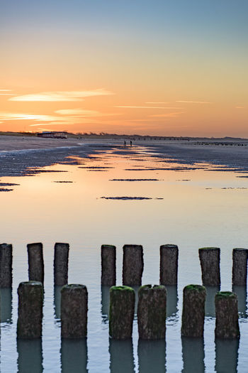 Zeeland sunset Beach Beauty In Nature Copy Space Day Full Frame Horizon Over Water Nature No People No People, Outdoors Scenics Sea Sky Sunset Sunset_collection Tranquil Scene Tranquility Water Wooden Post The Great Outdoors - 2017 EyeEm Awards Lost In The Landscape