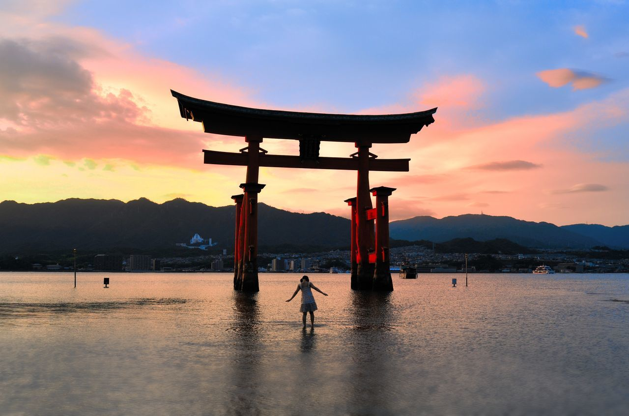 A glorious sunset on the Island of Itsukushima (also known as Miyajima). To experience Miyajima, you should stay in the island at least one night as the island seems transformed to something magical when most of the tourists have gone back to the main island. Architecture Beauty In Nature Built Structure Cloud - Sky Day Japan Japan Photography Lifestyles Miyajima Nature Outdoors Scenics Sea Silhouette Sky Sunset Tranquil Scene Tranquility Travel Destinations Water Neighborhood Map