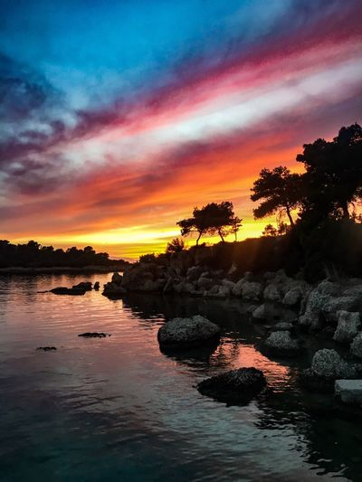 Sunset Scenics Beauty In Nature Sky Tranquil Scene Tranquility Water Tree Cloud - Sky Reflection Rock - Object Waterfront No People Landscape Outdoors Sea Nature Orange Color Greece Pelloponisos Porto Heli Travel Destinations Travel Photography