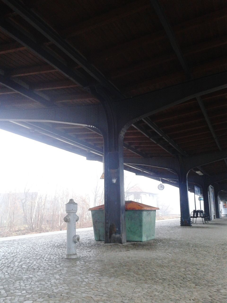 rear view, one person, day, full length, winter, real people, indoors, cold temperature, built structure, transportation, architecture, standing, architectural column, sky, snow, men, nature, under, people