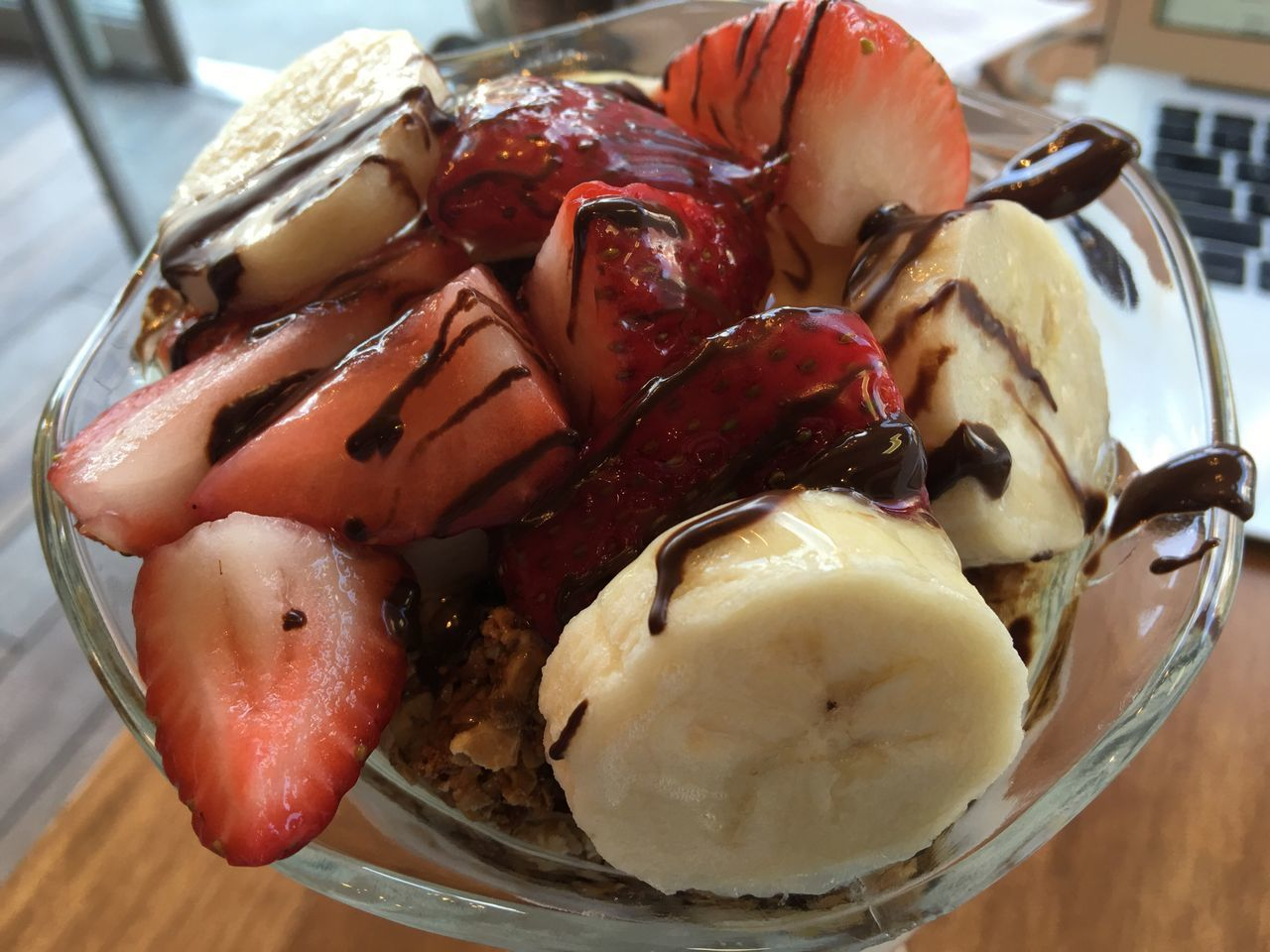 High Angle View Of Granola With Strawberry And Banana Slices In Bowl On Table