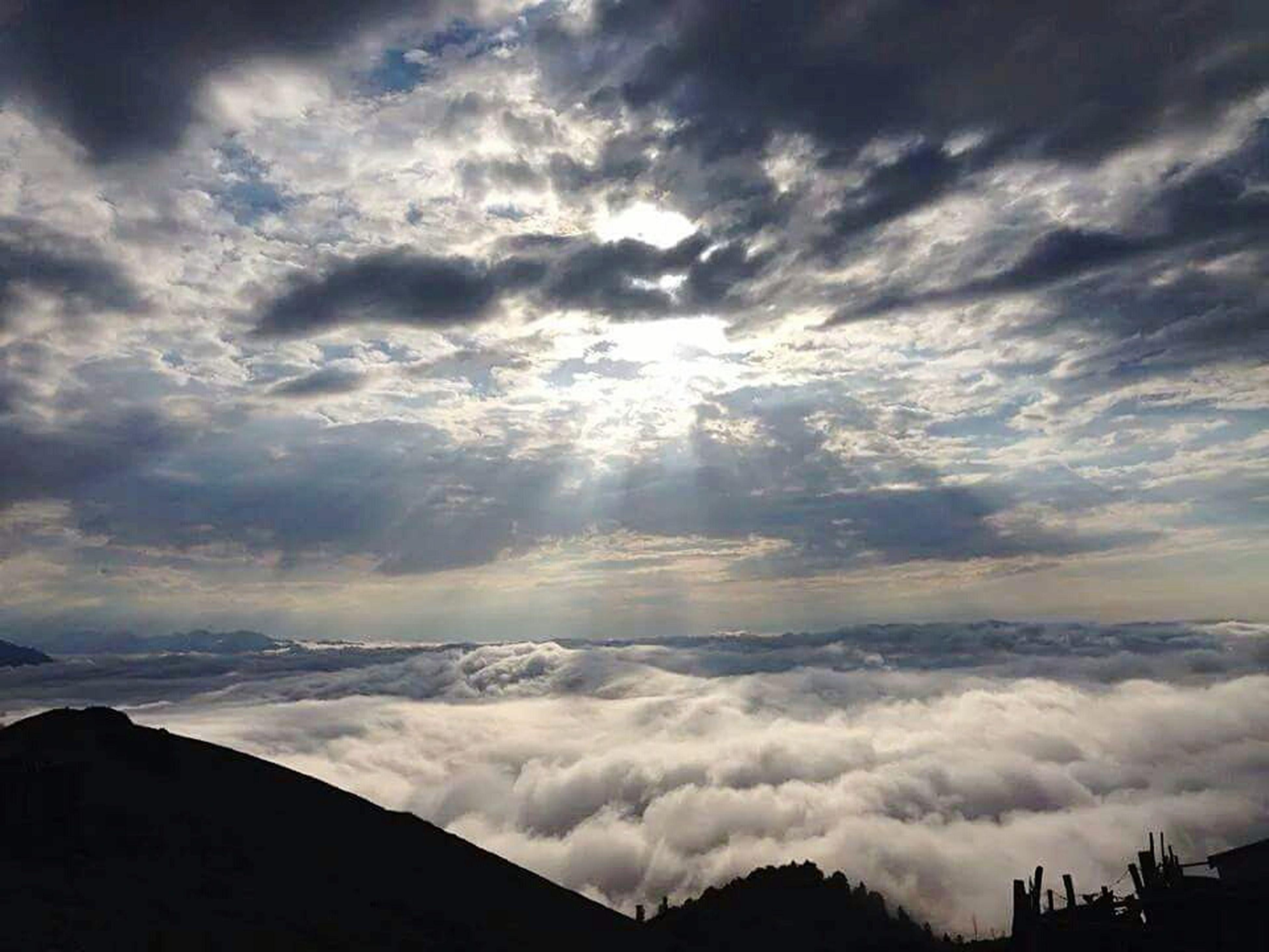 scenics, sky, cloud - sky, tranquil scene, beauty in nature, tranquility, mountain, silhouette, cloudy, weather, nature, mountain range, landscape, sunset, cloud, idyllic, cloudscape, dramatic sky, majestic, overcast