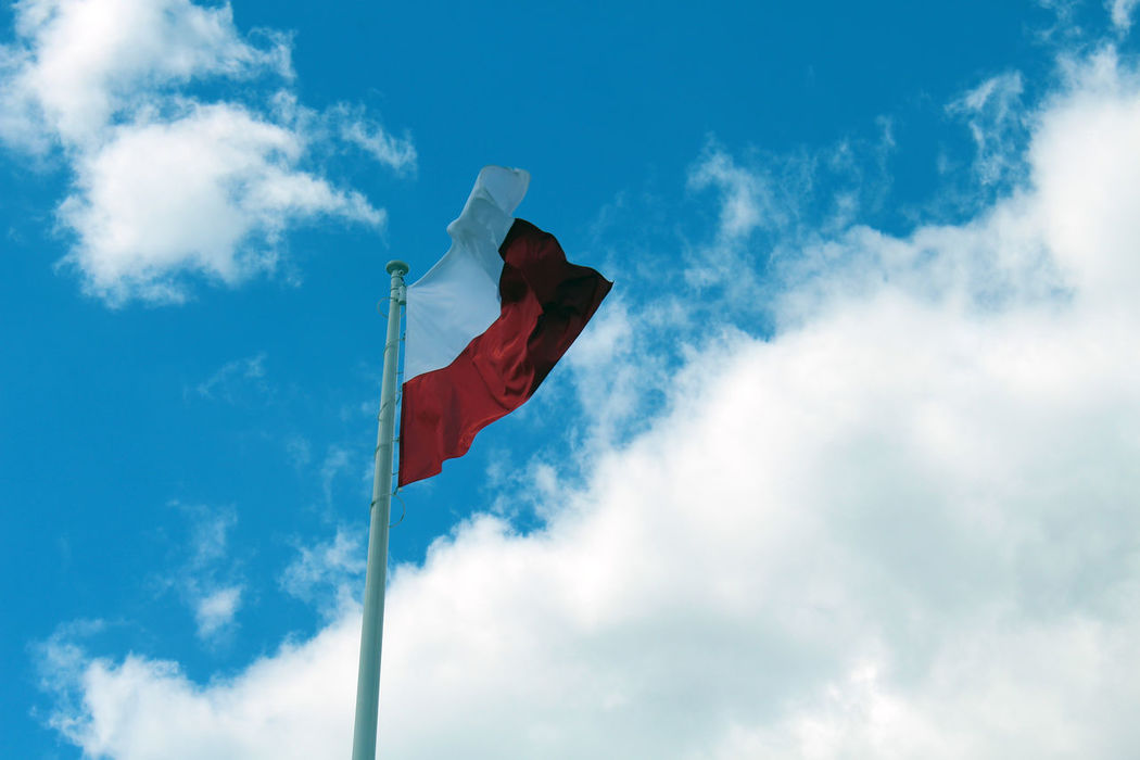 Polish Flag Beauty In Nature Blue Cloud Cloud - Sky Cloudy Culture Day Flag Low Angle View Multi Colored Nature No People Outdoors Poland Pole Redandwhite Sky Sunny Tranquility Wind