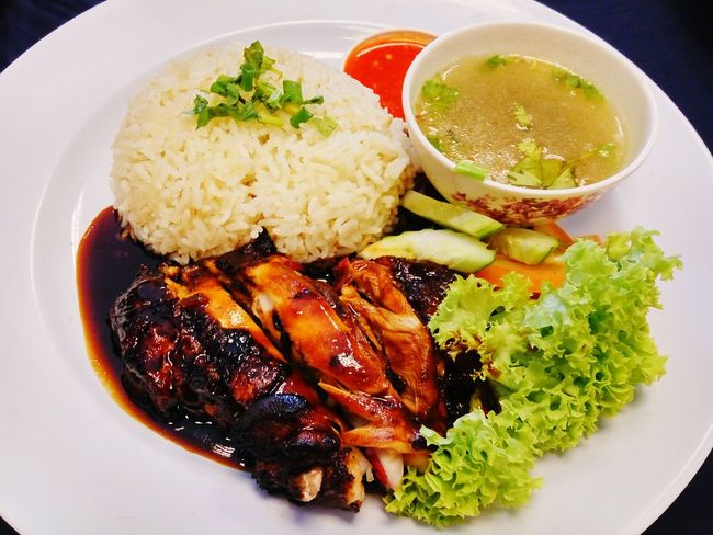 Chicken rice served with salad and chili sauce Food Plate Ready-to-eat No People Healthy Eating Indoors  Close-up Freshness Delicious Foods Tasty Cuisine Local Food Fried Rice Malaysian Spicy Chili  Steamed Rice Roasted Chicken Soup