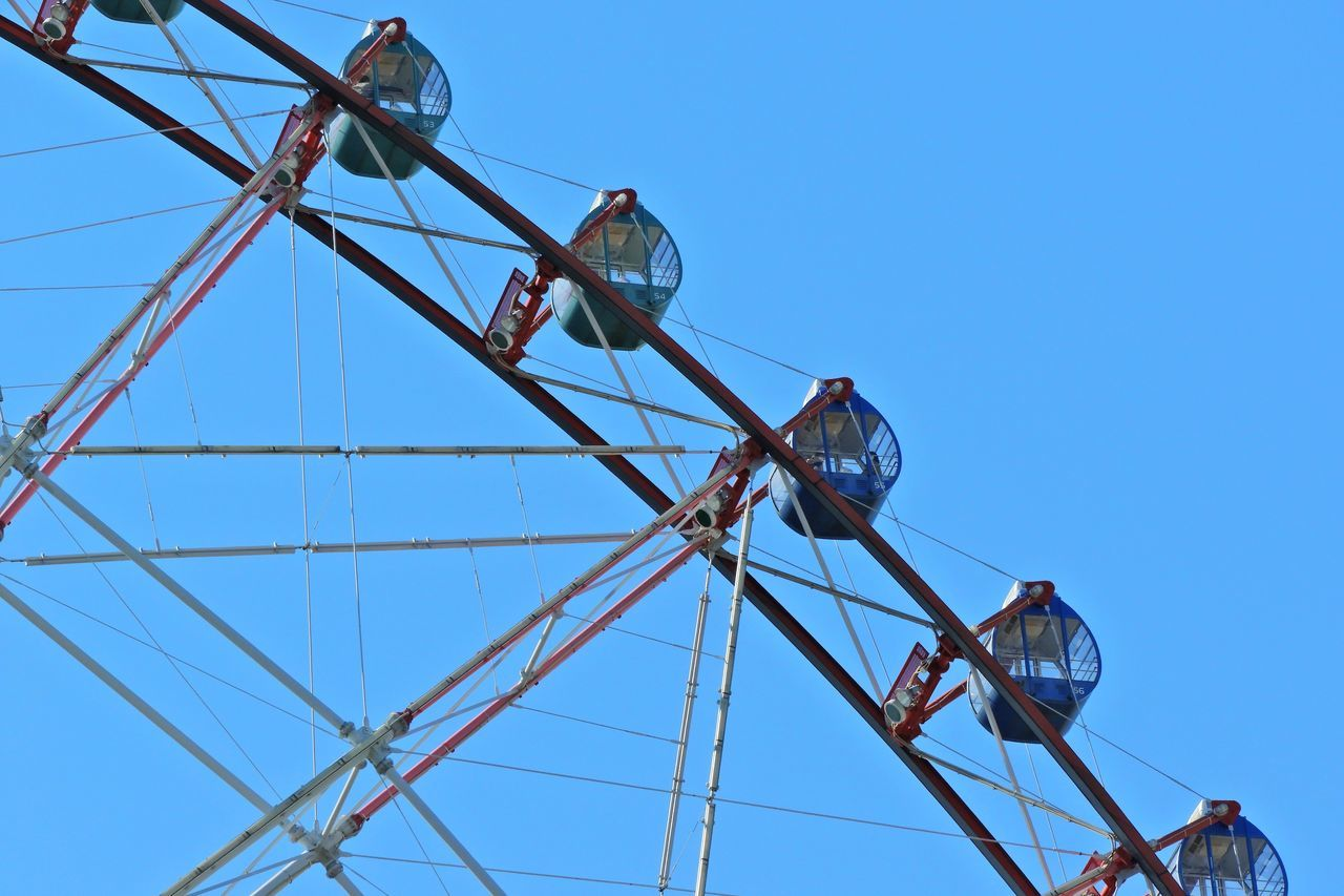 amusement park, arts culture and entertainment, amusement park ride, low angle view, ferris wheel, clear sky, blue, big wheel, day, outdoors, adventure, no people, sky, carousel