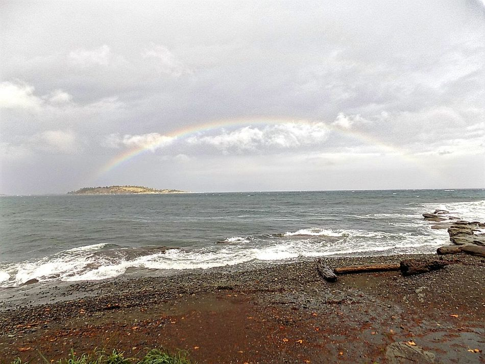 Beach Water Sea Scenics Rainbow Beauty In Nature Tranquil Scene Shore Tranquility Horizon Over Water Nature Multi Colored Sky Seascape Calm Cloudy Cloud - Sky Remote Outdoors Day Beach Scenes Stormy Weather Weather Photography No People Bcstorm