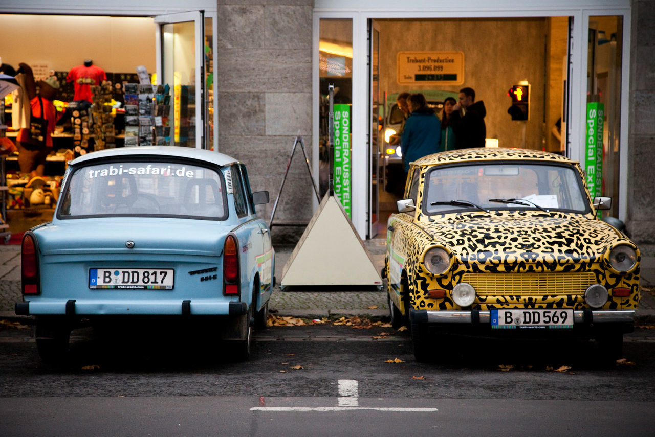 Berlin Cars City City Life Day Eastberlin Germany Information Sign Leopard Print Mode Of Transport Outdoors Park Parking Small Car Store Trabant Trabi Westberlin Two Is Better Than One Capture Berlin