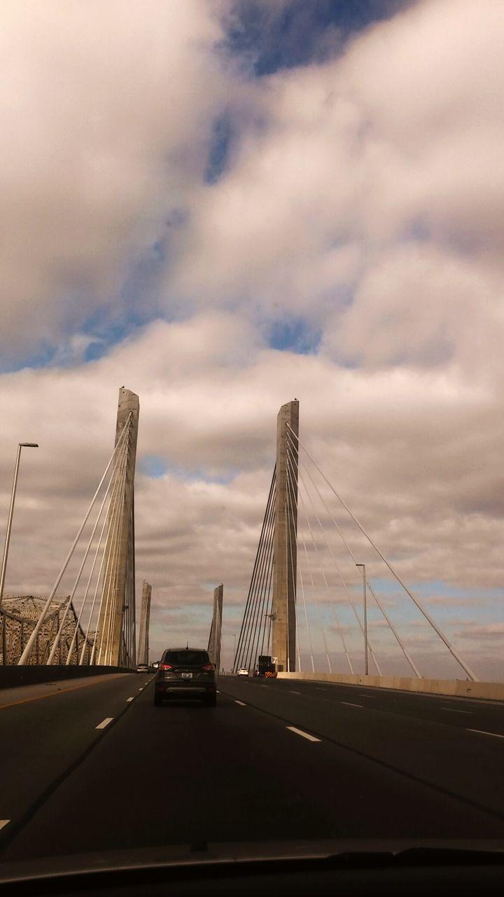 suspension bridge, connection, bridge - man made structure, sky, cloud - sky, transportation, architecture, built structure, no people, car, bridge, outdoors, travel destinations, city, day, chain bridge
