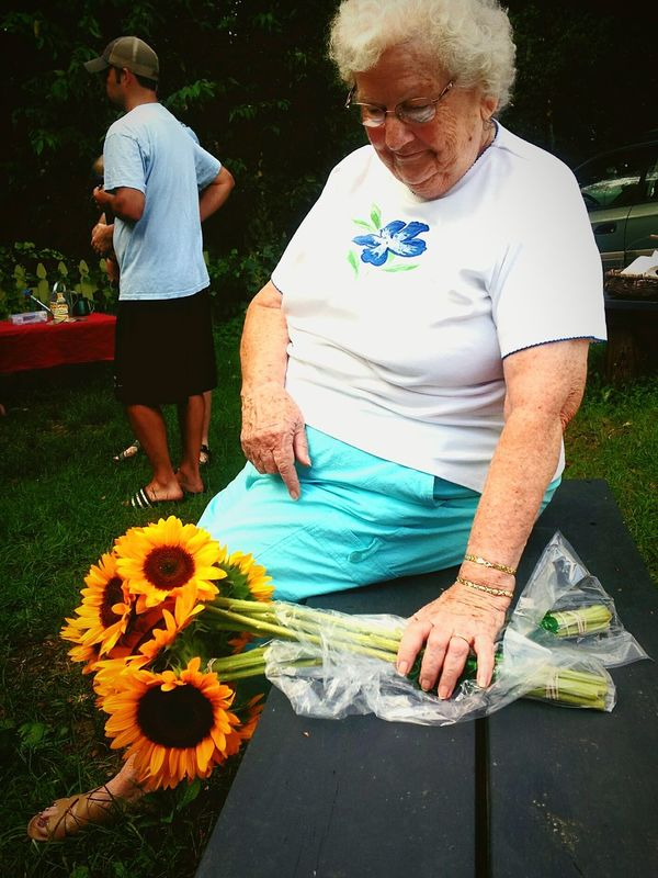Old Lady with Sunflowers Farmers Market Senior Citizen  Outdoors