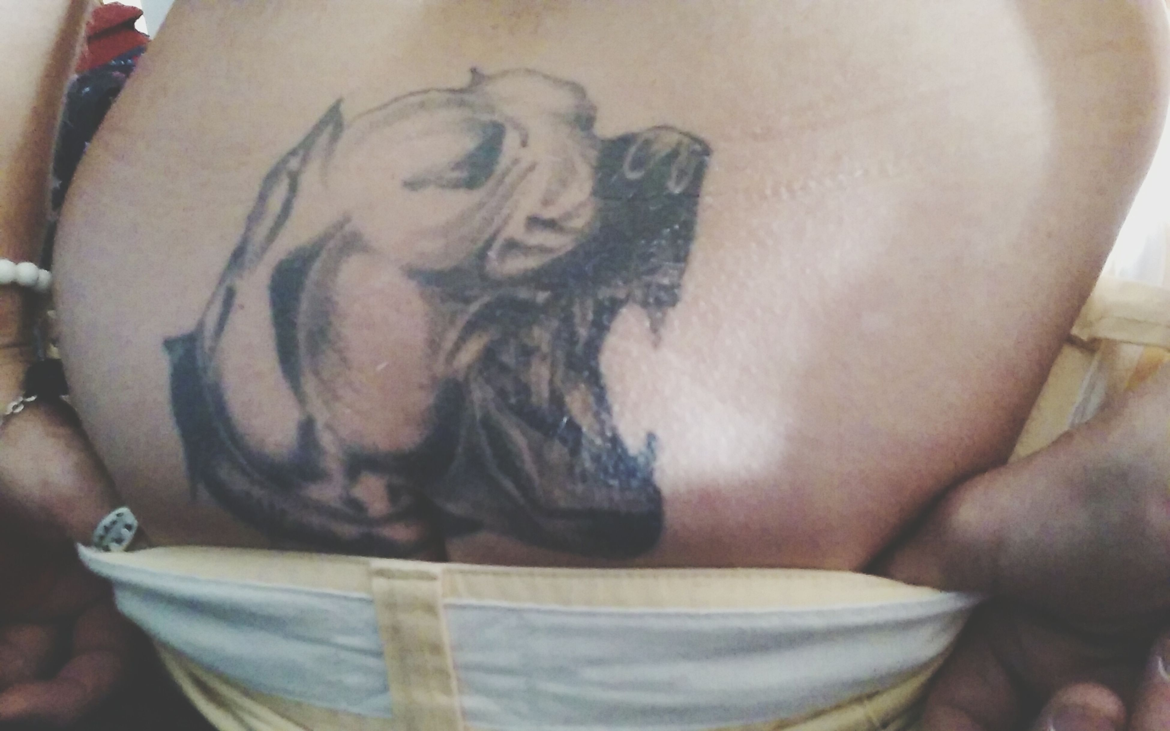 tramp stamp. represents big dogs in my backyard . done by....... H.A. Jim