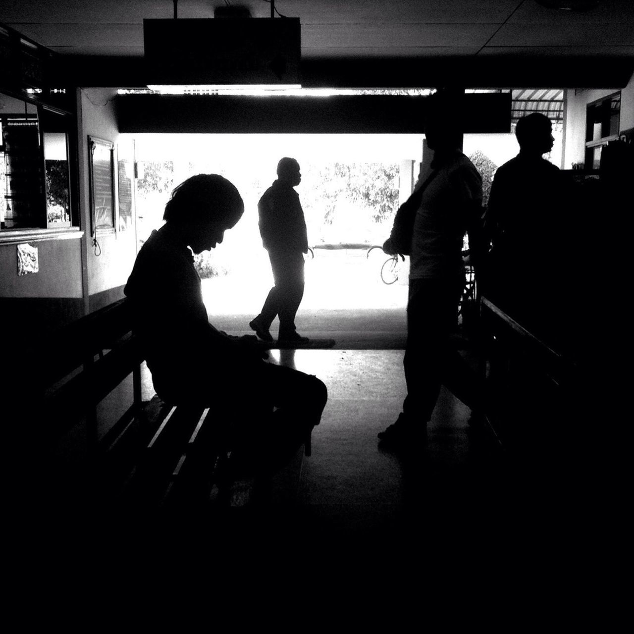 real people, men, silhouette, indoors, walking, standing, women, waiting, full length, public transportation, transportation, lifestyles, togetherness, day, adult, people