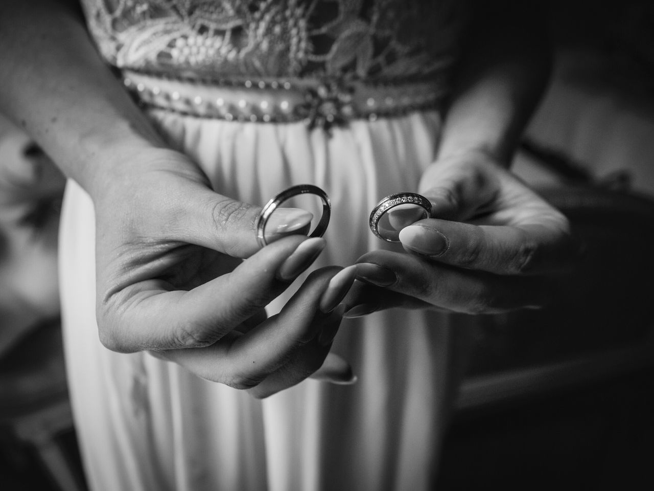 Midsection Of Woman Holding Rings