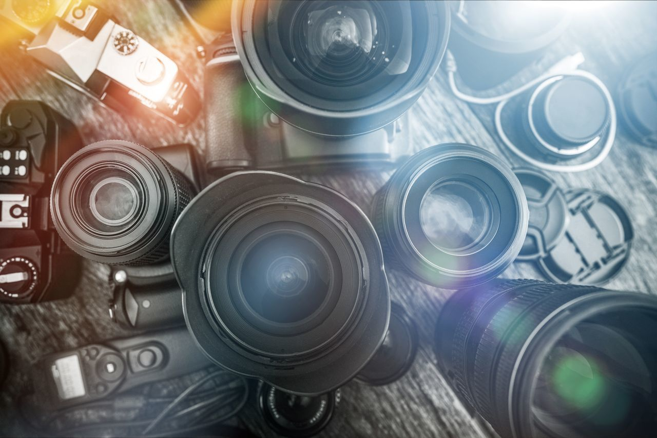 Photography Equipment on the Aged Wooden Desk. Camera and lenses. Aerosol Can Close-up Day Digital Camera Imaging Indoors  Lens Lenses No People Optic Photo Photography Photography Themes
