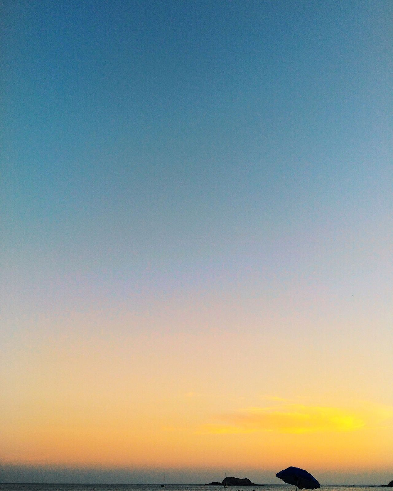 Beauty In Nature Blue Clear Sky Dusk Horizon Over Water Nature Sea Silhouette Sky Sunset Tranquil Scene Tranquility Water Waterfront