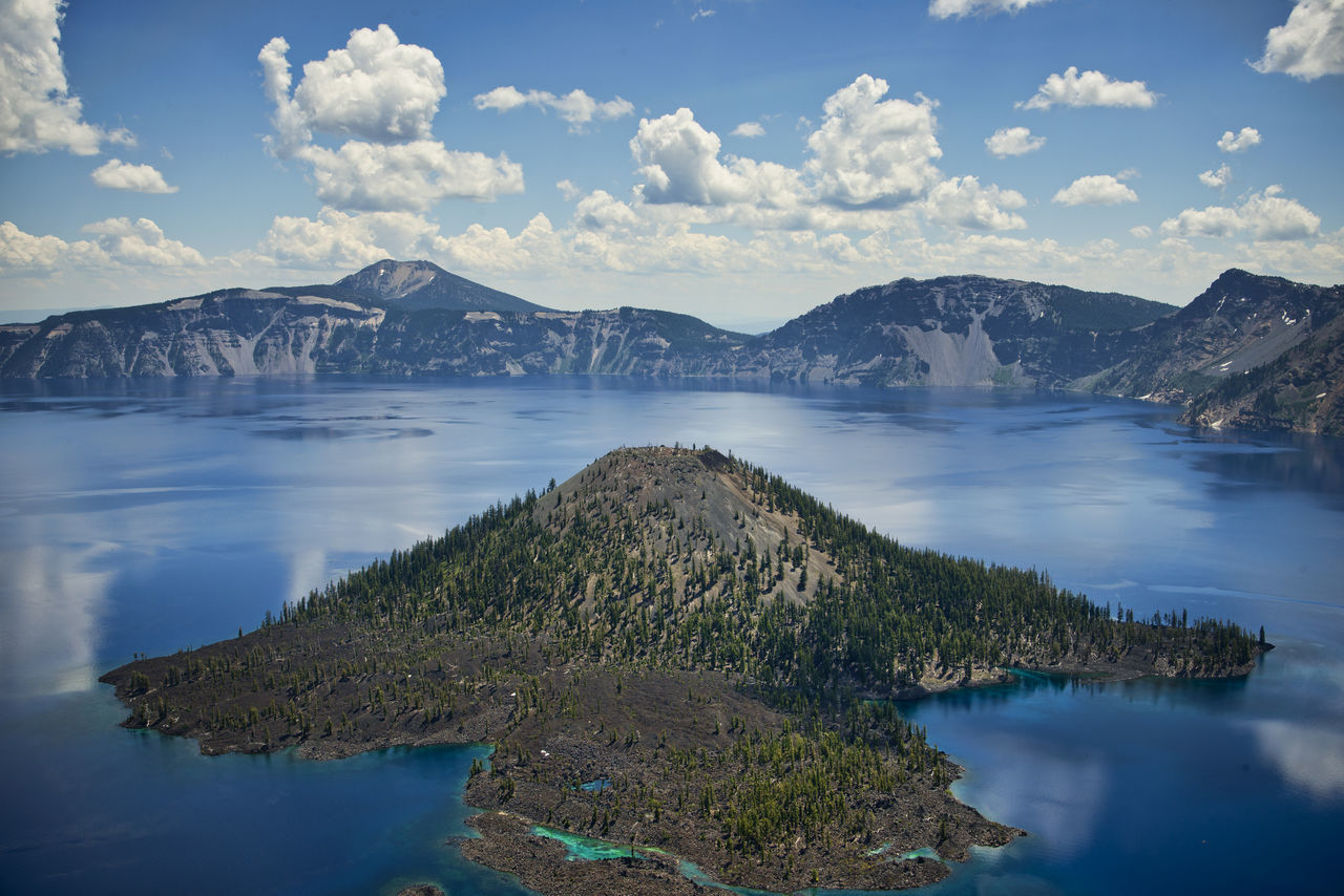 Crater Lake, Oregon America Blue Water Clouds And Sky Crater Lake National Park Horizontal Composition Lake Landmark Landscape_photography Mountains National Park Nature Nobody Oregon Outdoors Scenic View Tourist Destination Travel Destinations Trees Volcanic Lake Wilderness Area