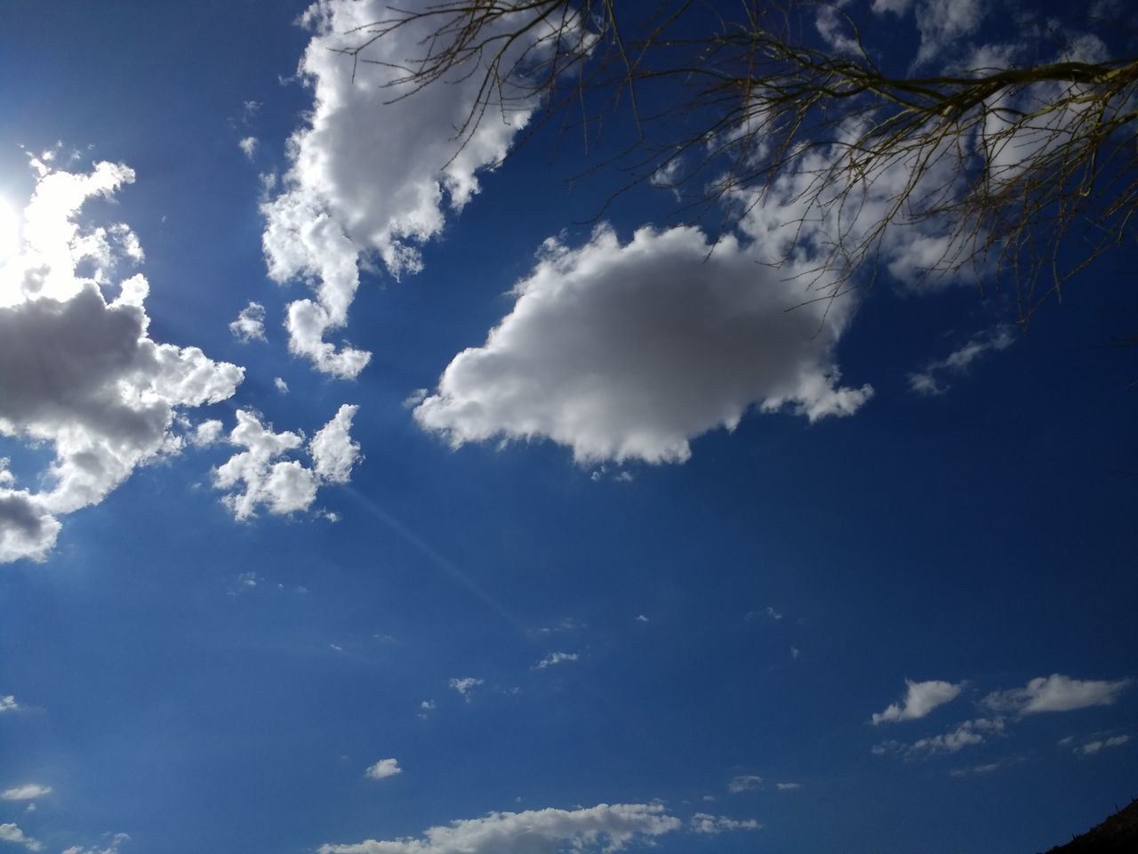 nature, sky, beauty in nature, low angle view, cloud - sky, blue, scenics, tranquility, day, backgrounds, sky only, tranquil scene, no people, outdoors, sunlight, full frame