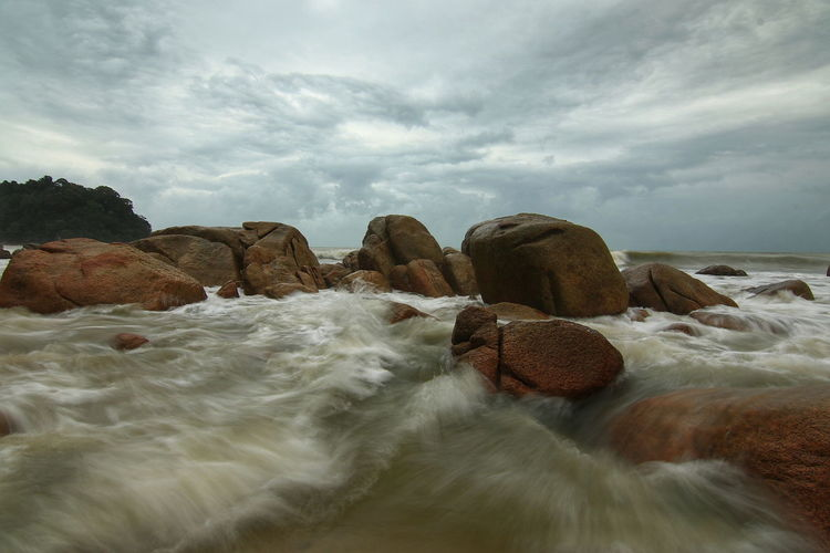 Monsoonseason Beach Sea Water Landscape Rock - Object Cloud - Sky Nature Beauty In Nature No People Outdoors Sand Sky Day Wave