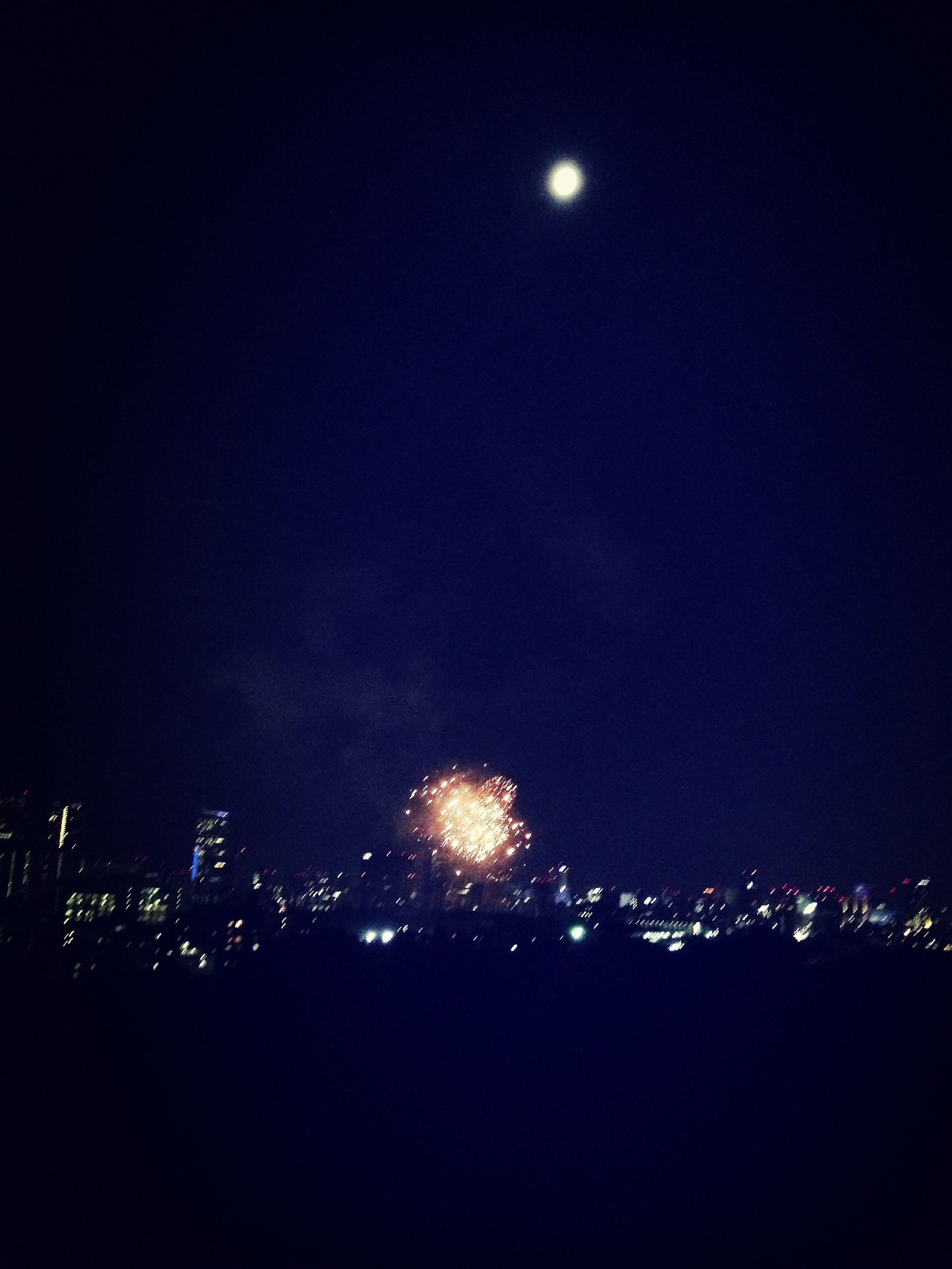 night, illuminated, city, cityscape, building exterior, moon, built structure, architecture, sky, dark, glowing, copy space, light, full moon, light - natural phenomenon, clear sky, lighting equipment, outdoors, no people, firework display