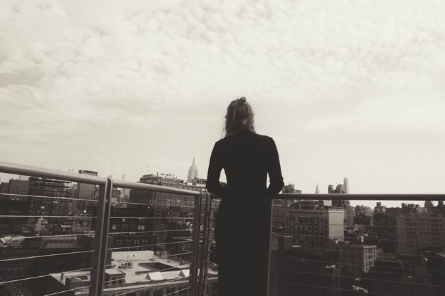 Standing Rear View Railing City Tourist Looking At View Sky Vacations Tourism Casual Clothing Person Long Hair Cloud - Sky Day City Life Carefree