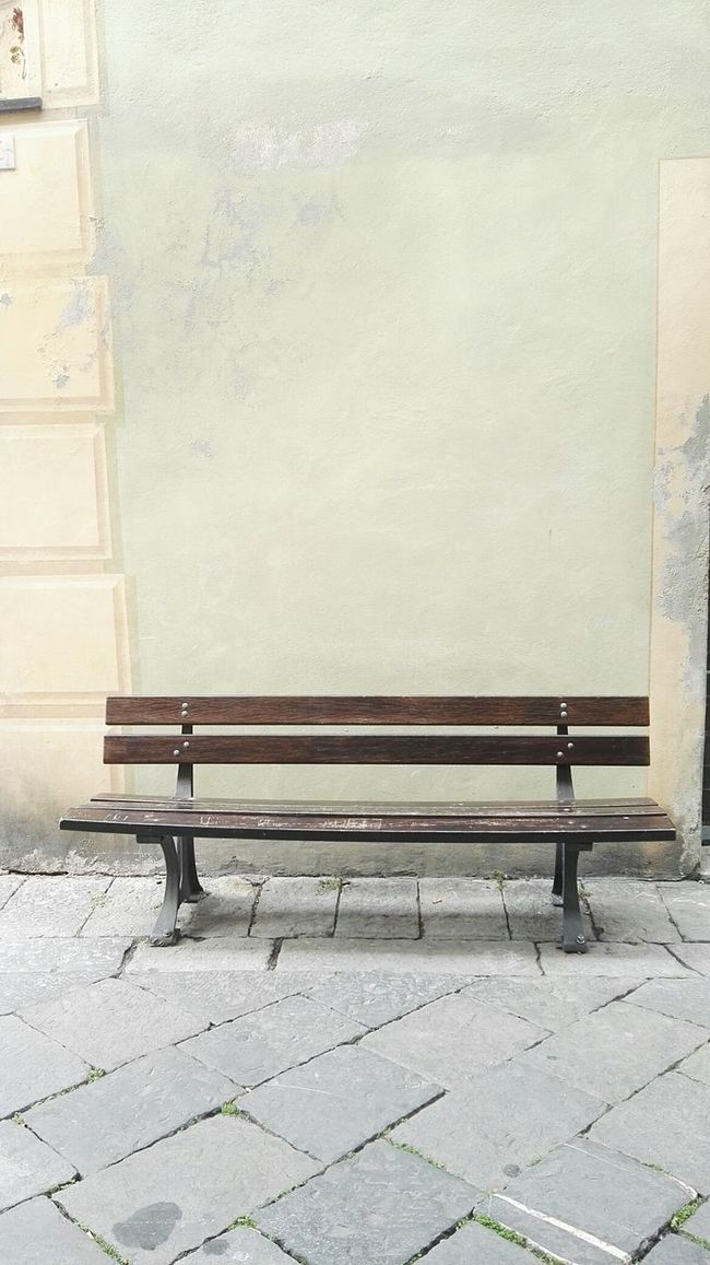 Albenga Architecture Bench Bench Building Exterior Built Structure Closed Day Full Length Italy Lifestyles Men Pastel Pastel Power Rear View Shadow Sidewalk Standing Steps Sunlight Walking Wall Wall - Building Feature