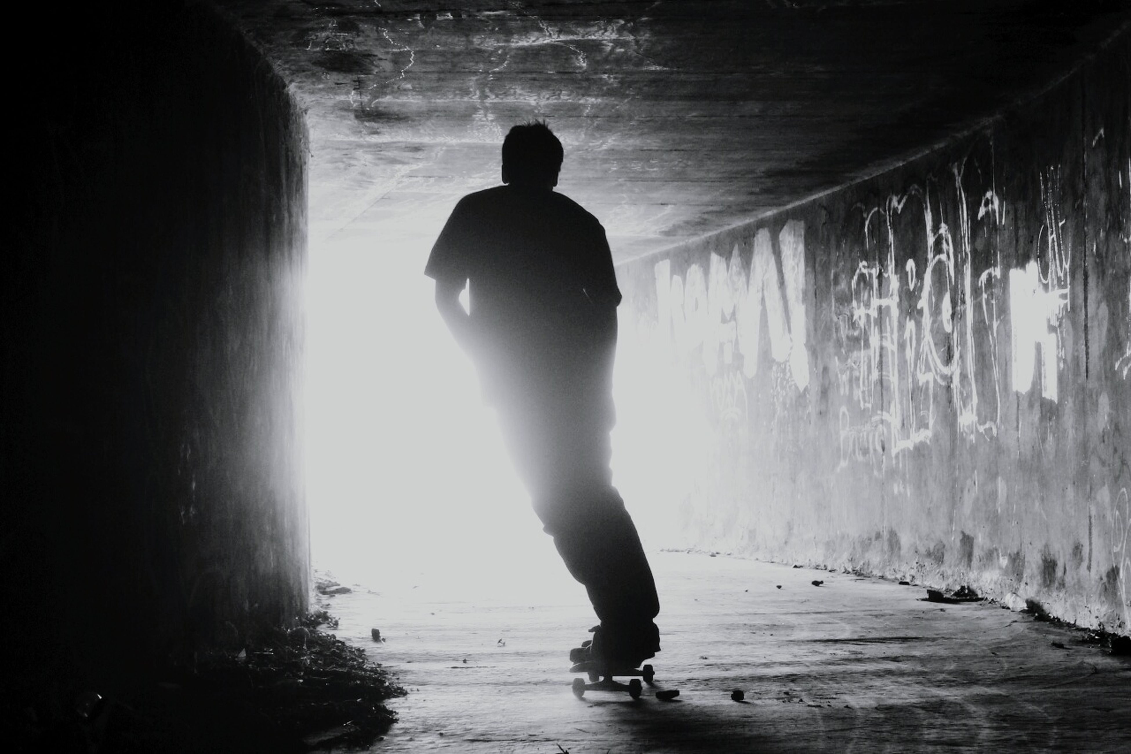 full length, lifestyles, rear view, leisure activity, men, indoors, silhouette, walking, standing, person, sunlight, water, boys, casual clothing, childhood, built structure, day