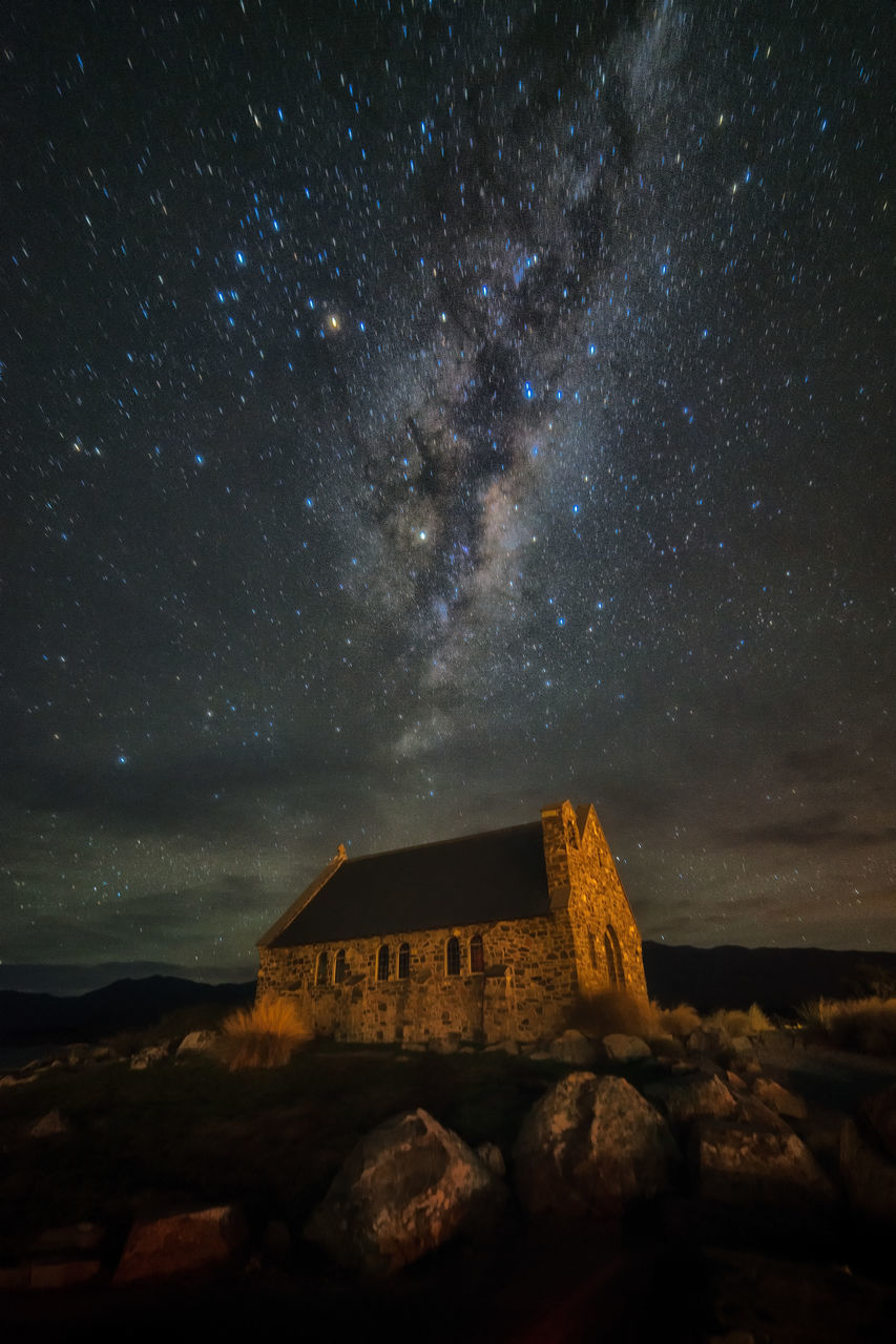 sky, star - space, night, astronomy, rock - object, scenics, nature, beauty in nature, built structure, galaxy, no people, tranquil scene, tranquility, outdoors, cloud - sky, architecture, starry, building exterior, constellation, milky way, water